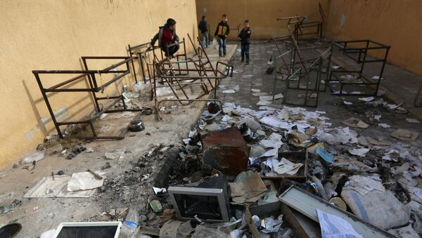 Students stand amid damaged desks and books in 'Aisha Mother of the BelieversÕ school which was recently reopened after rebels took control of al-Rai town from Islamic State militants, Syria January 17, 2017 - Sputnik International