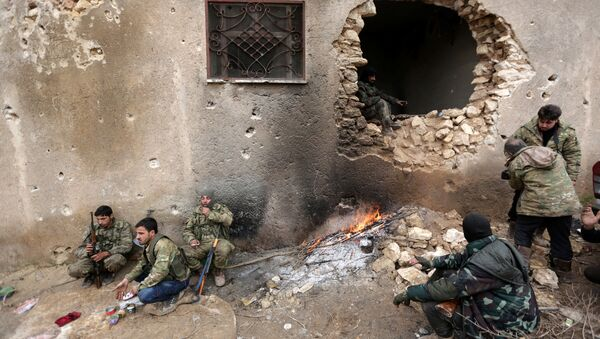 Rebel fighters rest near a hole in the wall by a fire on the outskirts of the northern Syrian town of al-Bab, Syria January 15, 2017 - Sputnik International