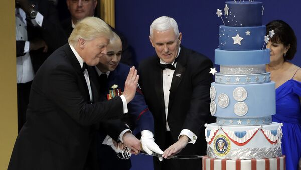 President Donald J. Trump, left, and Vice President Mike Pence, right, are helped by Coast Guard Petty Officer 2nd Class Matthew Babot, center, as they cut a cake at The Salute To Our Armed Services Inaugural Ball Friday, Jan. 20, 2017, in Washington. - Sputnik International