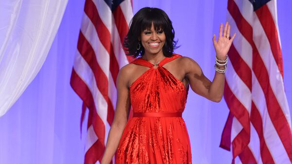 US President Barack Obama and First Lady Michelle Obama attend the Commander-in-Chief's Ball, honoring US service members and their families, at the Walter E. Washington Convention Center on January 21, 2013 in Washington, DC. - Sputnik International