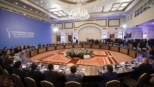 Delegations of Russia, Iran and Turkey hold talks on Syrian peace at a hotel in Astana, Kazakhstan, Monday, Jan. 23, 2017. - Sputnik International