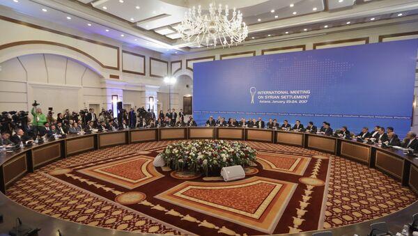 Delegations of Russia, Iran and Turkey hold talks on Syrian peace at a hotel in Astana, Kazakhstan, Monday, Jan. 23, 2017 - Sputnik International
