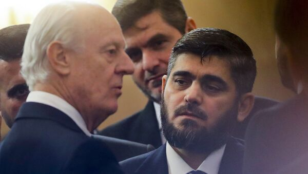 U.N. Special Envoy for Syria Staffan de Mistura, left, speaks to head of Syrian opposition delegation Mohammed Alloush, right, prior to talks on Syrian peace at a hotel hall in Astana, Kazakhstan, Monday, Jan. 23, 2017. - Sputnik International