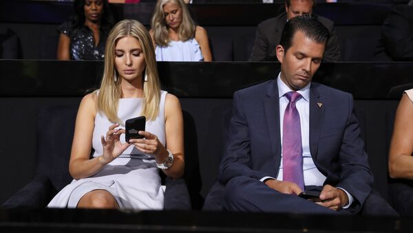 Republican Presidential Candidate Donald Trump's children Ivanka Trump and Donald Trump Jr., check on their phones during the second day session of the Republican National Convention in Cleveland, Tuesday, July 19, 2016. - Sputnik International
