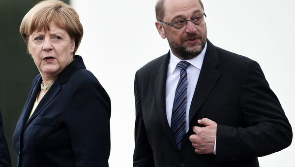 This file photo taken on May 29, 2016 shows German Chancellor Angela Merkel (L) and the President of the European Parliament Martin Schulz during a remembrance ceremony to mark the centenary of the battle of Verdun, at the Douaumont Ossuary (Ossuaire de Douaumont), northeastern France. - Sputnik International
