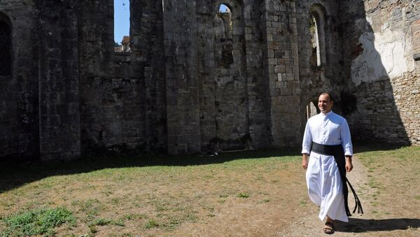 Father Guillaume Soury-Lavergne walks in the Benedictine abbey of Marcilhac-sur-Cele, in the Lot gorges, southern France. (File) - Sputnik International