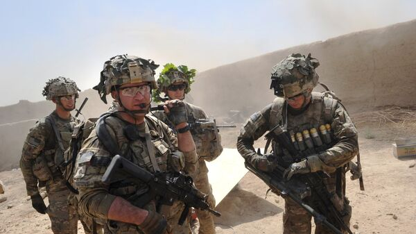 In this photo taken on August 5, 2011, US troops from the Charlie Company, 2-87 Infantry, 3d Brigade Combat Team under Afghanistan's International Security Assistance Force patrols Kandalay village following Taliban attacks on a joint US and Afghan National Army checkpoint protecting the western area of Kandalay village. - Sputnik International