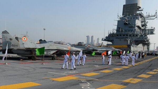 Naval personnel walk along India's largest naval ship the INS Vikramaditya as she anchors in the Sri Lankan capital Colombo on January 21, 2016 - Sputnik International