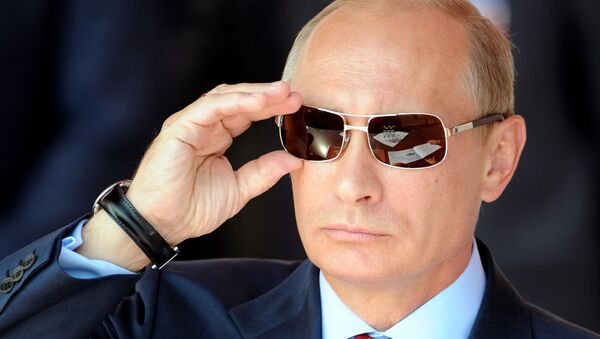 Russian Prime Minister Vladimir Putin adjusts his sunglasses as he watches an air show during MAKS-2011, the International Aviation and Space Show, in Zhukovsky, outside Moscow, on August 17, 2011 - Sputnik International