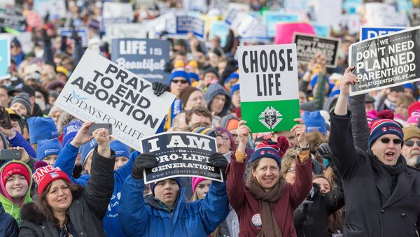 Pro Life supporters gather at the Washington Monument to hear Vice President Mike Pence speak at the March for Life rally on January 27, 2017 in Washington,DC - Sputnik International