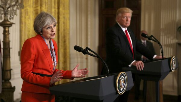 British Prime Minister Theresa May speaks as US President Donald Trump listens during their joint news conference at the White House in Washington, US, January 27, 2017 - Sputnik International
