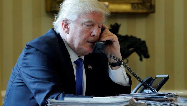 U.S. President Donald Trump speaks by phone with Russia's President Vladimir Putin in the Oval Office at the White House in Washington, U.S. January 28, 2017 - Sputnik International