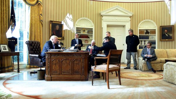 U.S. President Donald Trump (from L), joined by Chief of Staff Reince Priebus, Vice President Mike Pence, National Security Advisor Michael Flynn, Communications Director Sean Spicer and senior advisor Steve Bannon, speaks by phone with Russia's President Vladimir Putin in the Oval Office at the White House in Washington, U.S. January 28, 2017 - Sputnik International