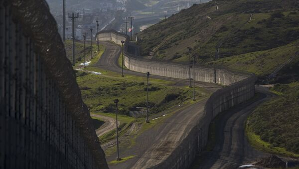 Multiple layers of steel walls, fences, razor wire and other barricades are viewed from the United States side of the of the US-Mexico border on January 26, 2017 in San Ysidro, California - Sputnik International