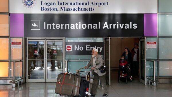 International travelers arrive after U.S. President Donald Trump's executive order travel ban at Logan Airport in Boston, Massachusetts, U.S - Sputnik International