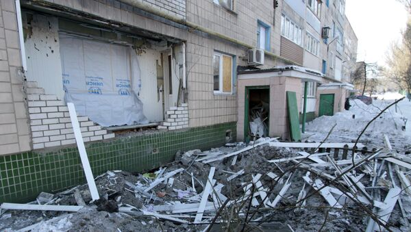 A destroyed balcony of a residential building on Partizanskaya Street in Donetsk, damaged during a shelling by the Ukrainian military - Sputnik International