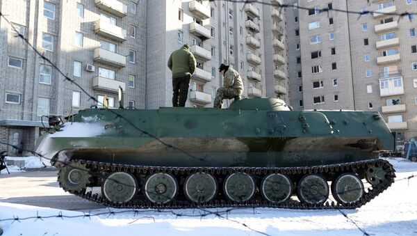 Ukrainian medical servicemen stand on an Armoured Personnel Carriers (APC) after they carried wounded servicemen to hospital in Ukraine-controlled town of Avdiivka, in Donetsk region - Sputnik International
