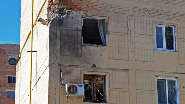 Shattered windows in a residential building in Donetsk, damaged during a shelling by the Ukrainian military - Sputnik International