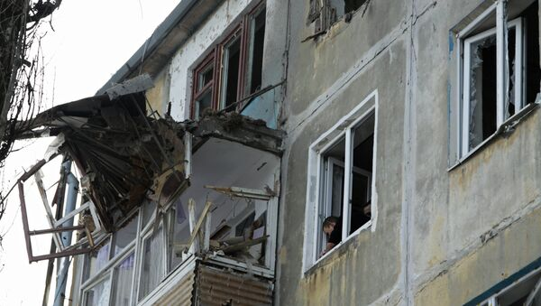 A residential building damaged by an attack of the Ukrainian armed forces in Donetsk - Sputnik International