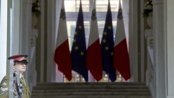 A Maltese army soldier stands in front of the main gate of the the Auberge de Castille palace, Premier's office, on the eve of an EU Summit, in Valletta, Malta - Sputnik International