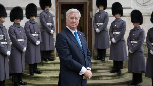 Britain's Defense minister Michael Fallon waits outside the Foreign Office on December 15, 2016 in London. - Sputnik International