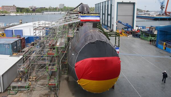 Shipyard workers and German soldiers attend the christening of the U36 new submarine of the 212A class for the German Marine at the ThyssenKrupp Marine Systems shipyard in Kiel, northern Germany. (File) - Sputnik International