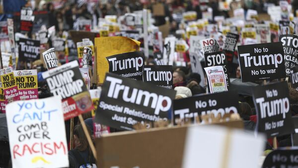 Demonstrators march against U.S. President Donald Trump and his temporary ban on refugees and nationals from seven Muslim-majority countries from entering the United States, during a protest in London, Britain, February 4, 2017 - Sputnik International