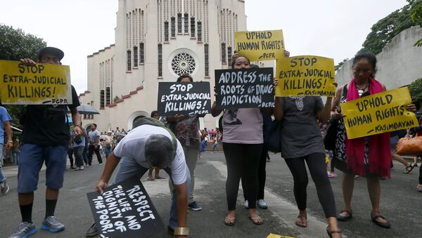 Human rights activists display placards outside the Baclaran Church prior to a mass in suburban Paranaque, south of Manila, Philippines. - Sputnik International