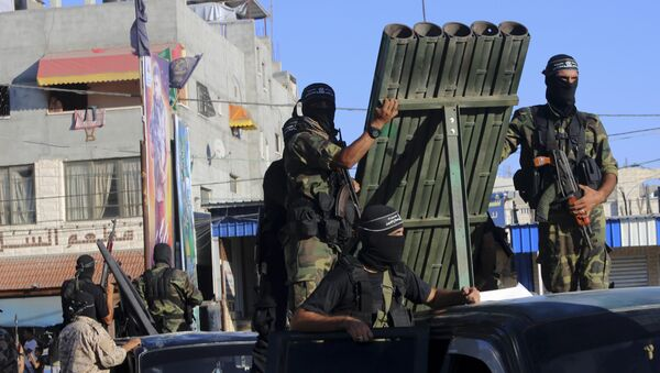 Palestinian militants from the al-Nasser Brigades, an armed wing of the Popular Resistance Committees (PRC), stand near rocket launcher while marching on their vehicles a long the streets during a rally to commemorate the 17th anniversary of their group in Rafah refugee camp, Gaza Strip, Monday, Sept. 26, 2016 - Sputnik International