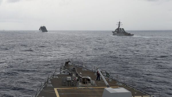This image provided by the U.S. Navy, taken Oct. 17, 2016, shows the guided missile destroyer USS Decatur, right, pulling into position behind the Military Sealift Command USNS Matthew Perry, during a replenishment-at-sea, seen from the bridge of the guided-missile destroyer USS Spruance, in the South China Sea - Sputnik International