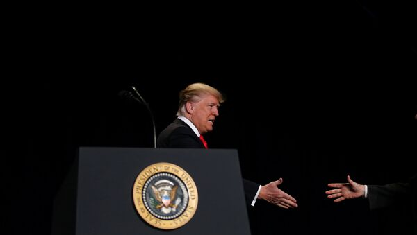 U.S. President Donald Trump shakes hands as he arrives at the National Prayer Breakfast in Washington, U.S., February 2, 2017 - Sputnik International