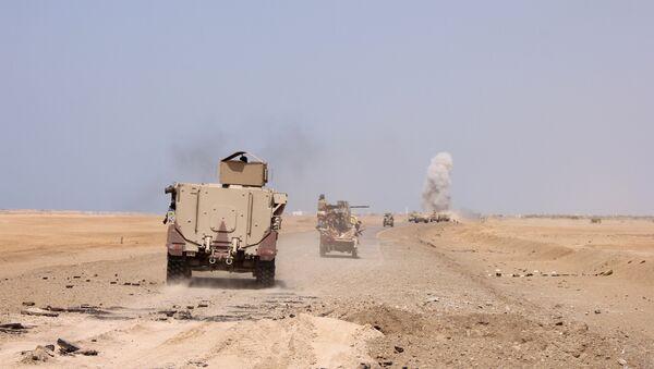 (File) Smoke rises as a Yemeni military armoured personnel carrier was hit by a Houthi rocket near the Red Sea coast city of al-Mokha, Yemen January 23, 2017 - Sputnik International