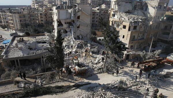 People inspect the damage at a site hit by airstrikes in the rebel-held city of Idlib, Syria February 7, 2017 - Sputnik International