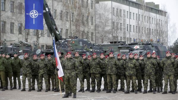 Netherlands' soldiers attend a ceremony to welcome the German battalion being deployed to Lithuania as part of NATO deterrence measures against Russia in Rukla, Lithuania February 7, 2017 - Sputnik International