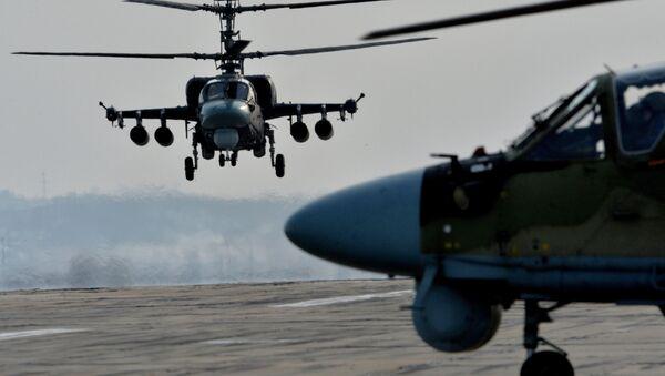 Ka-52 Alligator helicopters during tactical flight training. (File) - Sputnik International