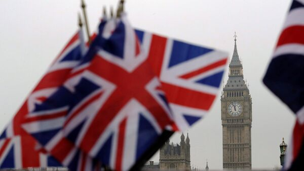 Union flags displayed on a tourist stall, backdropped by the Houses of Parliament and Elizabeth Tower containing the bell know as Big Ben, in London, Wednesday, February 8, 2017. - Sputnik International