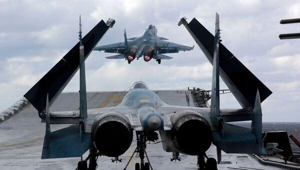 Su-33 and MiG-29K fighters aboard Admiral Kuznetsov heavy aircraft carrier in the Mediterranean Sea. - Sputnik International