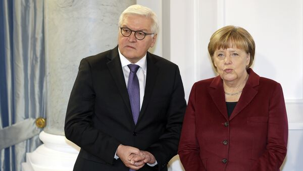 German Chancellor Angela Merkel, right, and German Foreign Minister Frank-Walter Steinmeier, left, talk as they pose for the media during a New Year's reception of German President Joachim Gauck at the Bellevue palace in Berlin, Germany, Tuesday, January 10, 2017. - Sputnik International