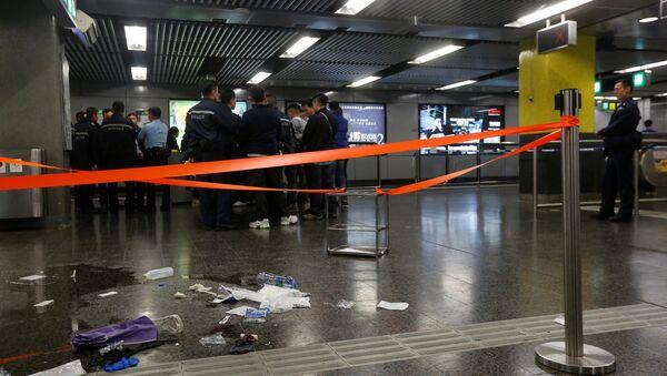 Police officers stand guard inside Tsim Sha Tsui subway station in Hong Kong, China - Sputnik International