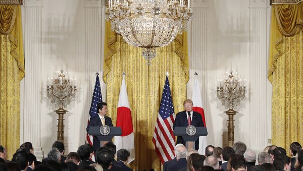 President Donald Trump and Japanese Prime Minister Shinzo Abe participate in a joint news conference in the East Room of the White House in Washington - Sputnik International