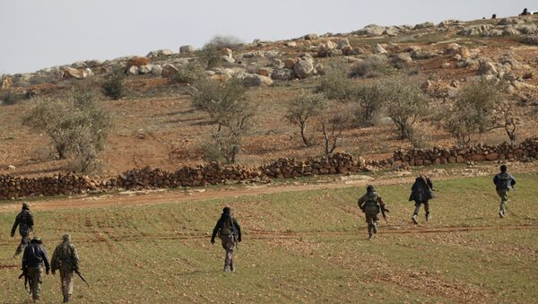 Free Syrian Army fighters are seen in al Baza'a village in the outskirts of al-Bab town, Syria - Sputnik International