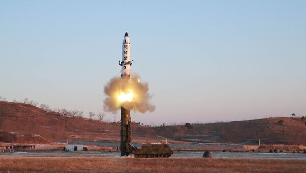 A view of the test-fire of Pukguksong-2 guided by North Korean leader Kim Jong Un on the spot, in this undated photo released by North Korea's Korean Central News Agency (KCNA) in Pyongyang February 13, 2017 - Sputnik International