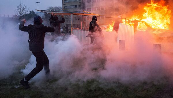 A car is ablaze in the Paris suburb of Bobigny during a protest against police brutality. file photo - Sputnik International