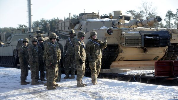 U.S. soldiers stand next to the M1 Abrams tanks that will be deployed in Latvia for NATO's Operation Atlantic Resolve in Garkalne, Latvia February 8, 2017 - Sputnik International