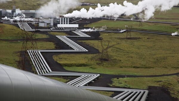 In this July 28, 2011 file photo, giant ducts carry superheated steam from within a volcanic field to the turbines at Reykjavik Energy's Hellisheidi geothermal power plant in Iceland. - Sputnik International