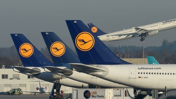 This file photo taken on November 29, 2016 shows airplanes of German airline Lufthansa parked in front of the Lufthansa terminal at the Franz-Josef-Strauss airport in Munich, southern Germany - Sputnik International