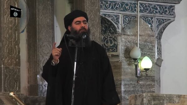 This July 5, 2014 photo shows an image grab taken from a propaganda video released by al-Furqan Media allegedly showing the leader of the Islamic State (IS) jihadist group, Abu Bakr al-Baghdadi, aka Caliph Ibrahim, adressing Muslim worshippers at a mosque in the militant-held northern Iraqi city of Mosul - Sputnik International