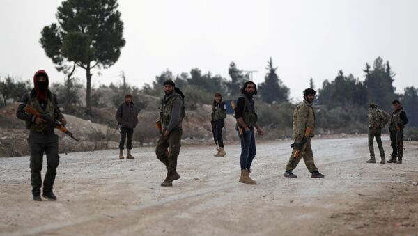 Free Syrian Army fighters carry their weapons as they stand on the outskirts of the northern Syrian town of al-Bab, Syria February 4, 2017. - Sputnik International