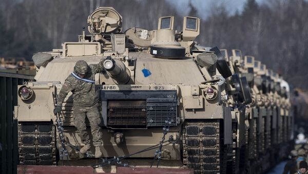 Abrams battle tanks from the US Army's 4th Infantry Division 3rd Brigade Combat Team 68th Armor Regiment 1st Battalion on rail cars as they arrive at the Gaiziunai railway station some 110 kms (69 miles) west of the capital Vilnius, Lithuania, Friday, Feb. 10, 2017. - Sputnik International