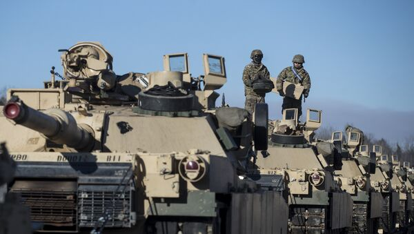 Members of US Army's 4th Infantry Division 3rd Brigade Combat Team 68th Armor Regiment 1st Battalion prepare to unload some Abrams battle tanks after arriving at the Gaiziunai railway station, some 110 kms (69 miles) west of the capital Vilnius, Lithuania, Friday, Feb. 10, 2017. - Sputnik International